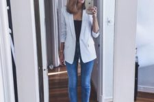 06 skinnies, a black top, a striped blazer and white shoes for a chic and comfy look