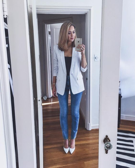 skinnies, a black top, a striped blazer and white shoes for a chic and comfy look