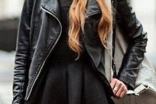 07 a black dress, black tights, a moto jacket, a beanie and a grey bag