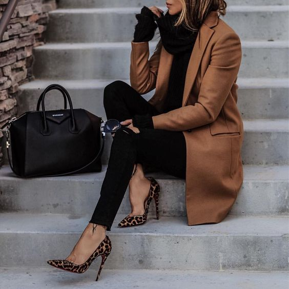 a brown coat, a black sweater, black skinnies, leopard print heels