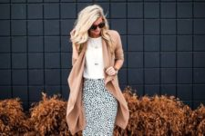 07 a dalmatian print knee skirt, a white top, a camel cardigan and lace up brown shoes
