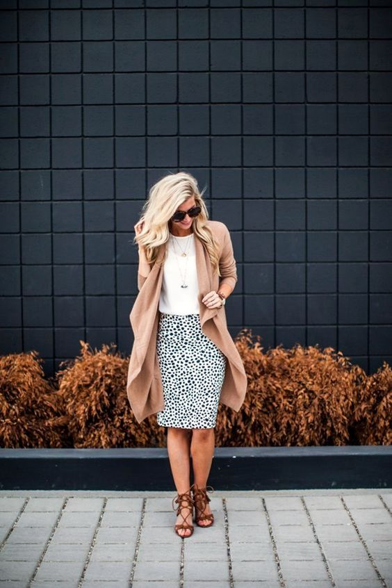 a dalmatian print knee skirt, a white top, a camel cardigan and lace up brown shoes
