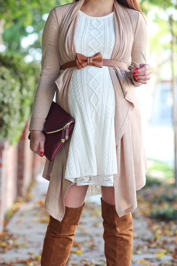 a white cable knit dress, a neutral cardigan with a bow belt and brown suede tall boots