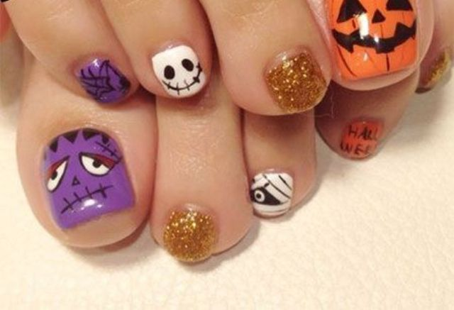 alluring toe nails with spooky faces, Frankestein in purple and  Jack-o-lanterns - 15 Impressive Halloween Toe Nails Designs - Styleoholic