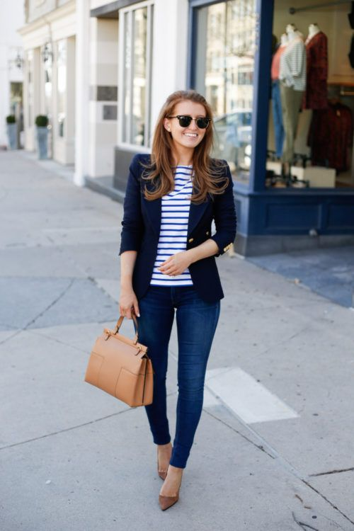 navy jeans, a striped blue and white shirt, a navy blazer, brown suede heels and a matching bag