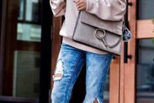 07 ripped blue jeans, a blush off the shoulder sweatshirt and blush heels