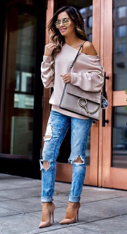 Picture Of ripped blue jeans a blush off the shoulder sweatshirt and blush heels
