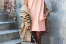 08 a blush dress, a neutral cardigan, white sneakers and a cltuch on chain
