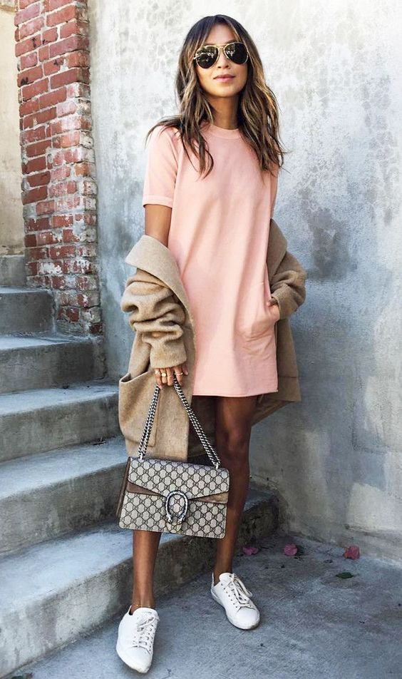 a blush dress, a neutral cardigan, white sneakers and a cltuch on chain