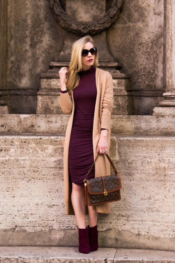 a draped burgundy knee dress and matching suede booties, a long camel cardigan
