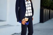 08 a navy suit with cropped pants, a window pane top, cobalt blue shoes and a clutch