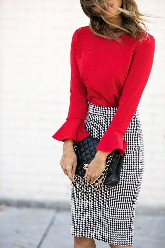 a red top with bell sleeves, a blakc and white gingham pencil skirt and a black bag