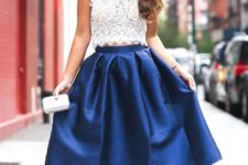 08 a sleeveless lace crop top, a statement necklace, a cobalt blue midi skirt, nude shoes