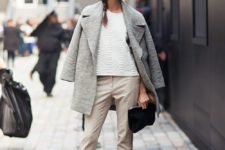 08 neutral cropped pants, black suede boots, a white textural top, a grey coat and a black clutch