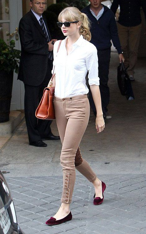 neutral pants on buttons, a white shirt and burgundy velvet flats