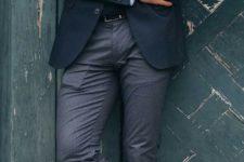 08 white chucks, a black blazer, a black swetaer, a shirt and a tie