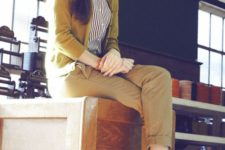 09 a black and white striped button-up shirt, a mustard cardigan, khaki trousers, low black heels
