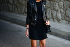 09 a black dress, black leather booties, a cropped black leather jacket and a bag