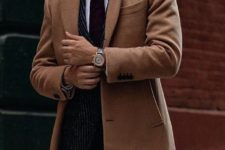 09 a thin striped suit with a burgundy tie and a camel coat for work