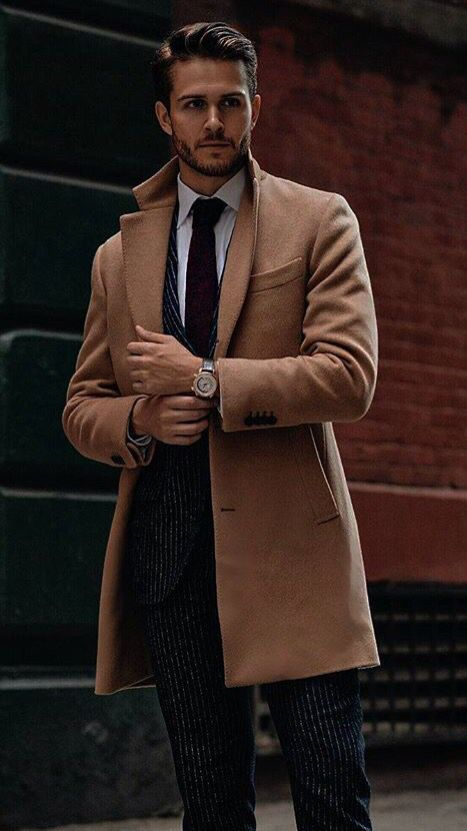a thin striped suit with a burgundy tie and a camel coat for work