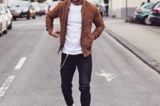 09 an amber suede bomber jacket, black jeans, a white tee and white sneakers
