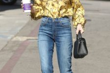 09 cropped blue jeans, a flowy yellow blouse with a floral print and burgundy velvet heels