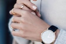 10 a gorgeous minimalist watch on a black leather band will fit many outfits