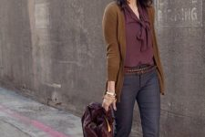 10 a grey cropped pants, a burgundy blouse with a bow, dark green cardigan, grey shoes and a plum bag