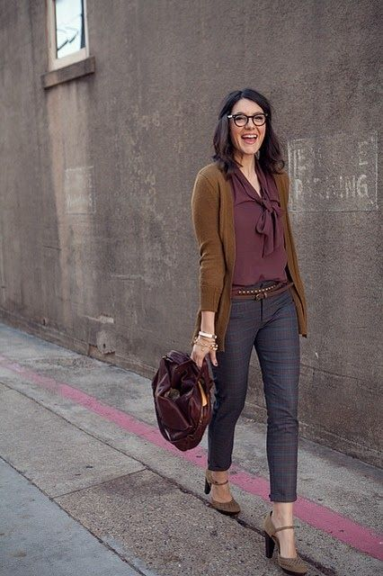 a grey cropped pants, a burgundy blouse with a bow, dark green cardigan, grey shoes and a plum bag