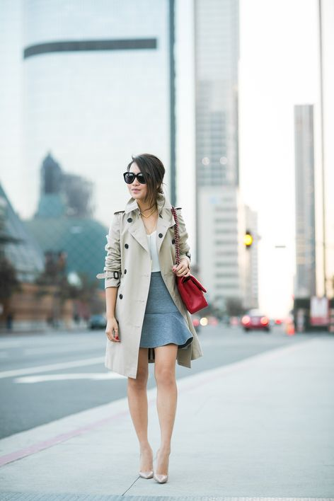 a grey flare skirt, a white top, nude hels and a beige trench coat to wear to work