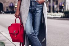 10 a grey top, a grey midi coat, cropped blue jeans, white slipons and a red backpack