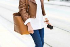 10 a layered look with a white sweater, navy jeans, a brown leather jacket, peep toe booties and large bag