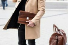 10 a relaxed look with a black sweater, jeans and boots and a camel coat on top
