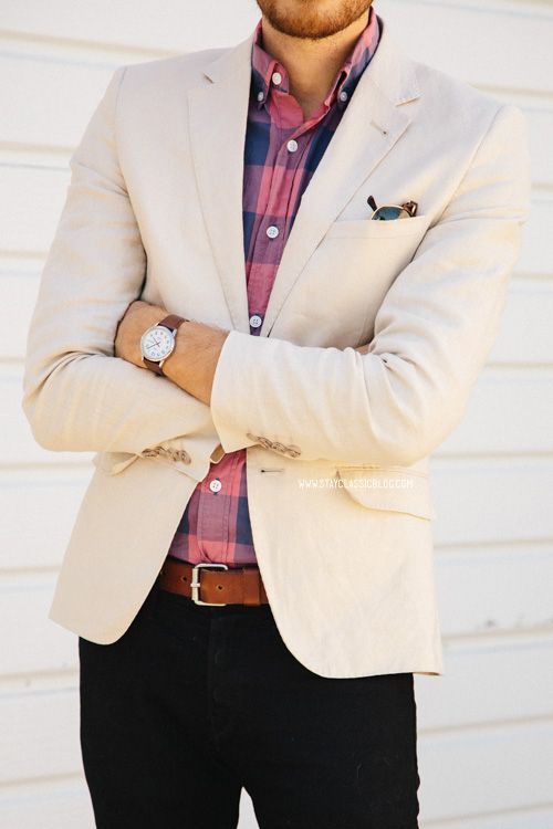 black jeans, a pink and blue plaid shirt and a creamy blazer