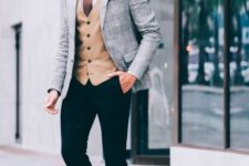 10 black pants, am amber vest, a white shirt, a brown tie and a grey jacket highlighted with cognac shoes