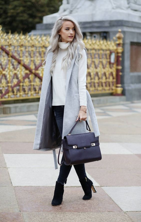 navy skinnies, a white turtleneck sweater, black suede booties and a grey sleeveless coat