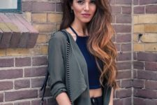 11 a navy crop top, navy jeans and an olive green light cardigan