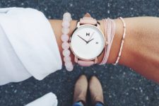 11 a watch with a pink leather band and pink bracelets for a feminine look