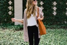 11 black cropped jeans, a white top, a neutral cardigan, amber shoes and an orange tote