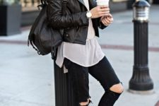 11 black distressed jeans, black suede booties, a white shirt, a black moto jacket and a backpack