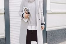 11 black skinnies, a grey sweater, a white shirt, a grey coat and black heels