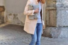 11 cropped jeans, a grey top, a peachy short coat, white sneakers