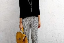 11 dalmatian print cropped pants, a black long sleeve top and a yellow bag