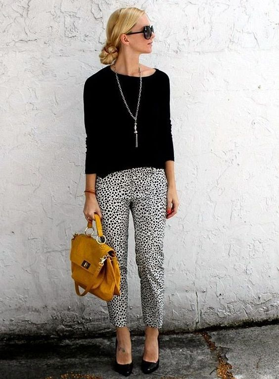 dalmatian print cropped pants, a black long sleeve top and a yellow bag