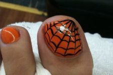 11 go for traditional Halloween colors – orange and black and paint a spider web on one of the nails