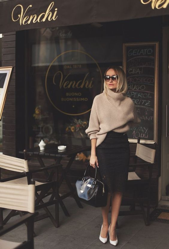a black pencil skirt, an oversized camel sweater, white heels and a black bag