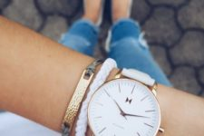 12 a large watch on a white leather band with a couple of matching bracelets accentuates your look