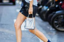 12 a leather mini, a chunky knit blue sweater, cobalt blue velvet booties and a small bag