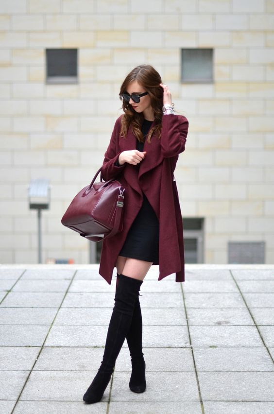 a little black dress, black suede high boots, a burgundy coat and a matching bag