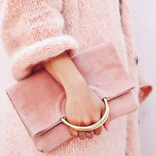 a pink suede clutch with handles looks very soft and girlish